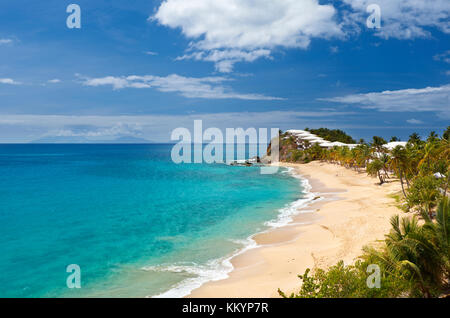 Curtain Bluff Beach and Resort in Antigua. On the horizon the active volcano of Montserrat, just starting a bigger - Stock Photo