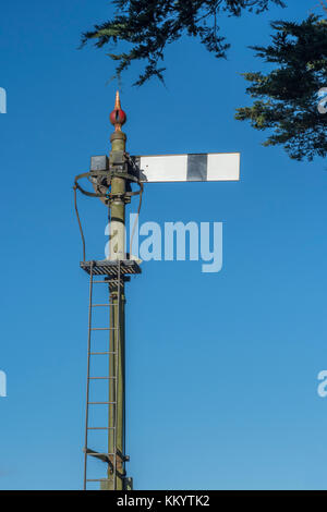 Old-style railway Semaphore signal in Cornwall, set against a bright - Stock Photo