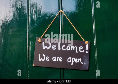 Sign of shop saying 'We are Open' - Stock Photo