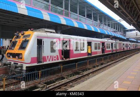 People travel at Dadar train station in Mumbai India. - Stock Photo