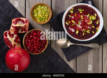 Pomegranate desert with Chia Seed, tapioca pudding and Yogurt. healthy eating. top view. - Stock Photo