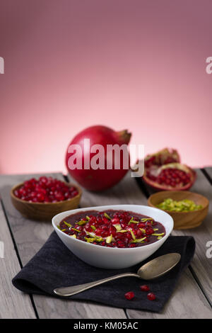 Pomegranate desert with pistachios, Chia Seed, tapioca pudding and Yogurt. healthy eating. pink copy space. - Stock Photo