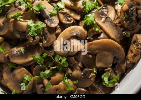Sautéed mushrooms with parsley and white wine - Stock Photo