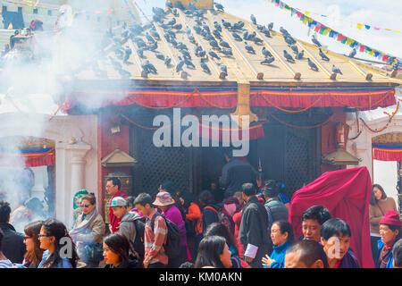 Buddhist pilgrims entering the Boudhanath Stupa, Largest Asian Stupa, Unesco World Heritage Site, Kathmandu, Nepal, - Stock Photo