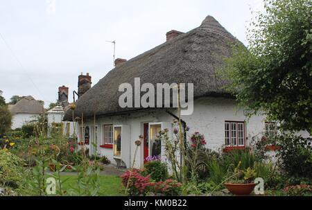 Irish Thatched Thatch Cottage Adare Limerick Ireland - Stock Photo