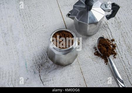 Preparing the coffee in a moka - italian coffee maker - Stock Photo
