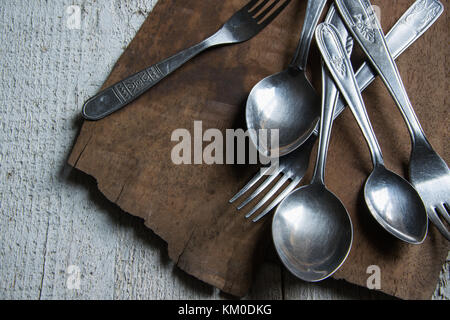 Detail of vintage cutlery on wooden table - Stock Photo