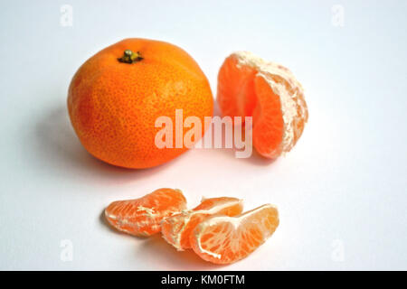 Closeup of tangerines on a white background - Stock Photo
