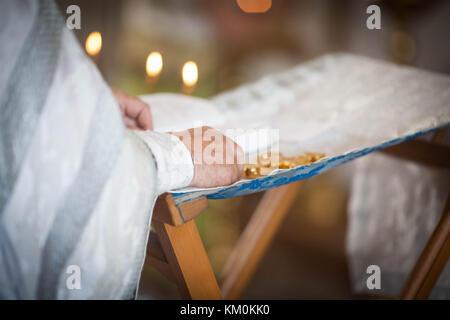 Orthodox priest reads a prayer - Stock Photo