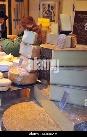 A selection of Swiss and french cheeses for sale on a market stall at Borough market, Southwark, London. Different - Stock Photo