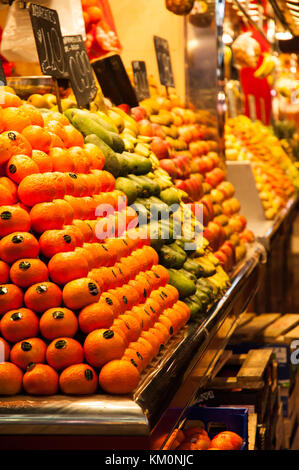 Assorted fruit and vegetables on sale at La Boqueria market in Barcelona. - Stock Photo