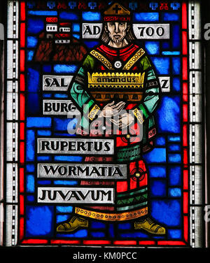 Stained Glass in Wormser Dom in Worms, Germany, depicting Rupert of Salzburg, Bishop of Worms as well as the first - Stock Photo
