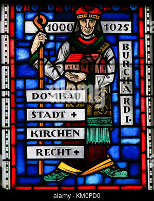Stained Glass in Wormser Dom in Worms, Germany, depicting Burchard of Worms, bishop of the Imperial City of Worms, - Stock Photo
