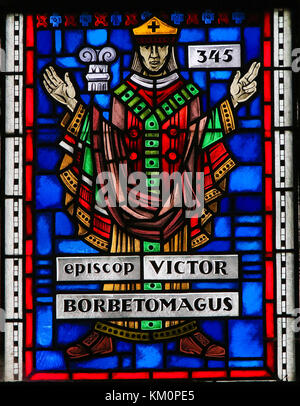Stained Glass in Wormser Dom in Worms, Germany, depicting Victor, Bishop of Worms in 345. - Stock Photo
