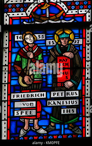 Stained Glass in Wormser Dom in Worms, Germany, depicting Friedrich Spee and Petrus Kanisiuis or Peter Canisius, - Stock Photo
