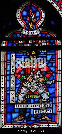 Stained Glass in Wormser Dom in Worms, Germany, depicting a French Soldier at the annexation of Worms into the French - Stock Photo