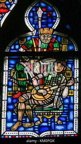 Stained Glass in Wormser Dom in Worms, Germany, depicting a Boy playing the Lute for a King - Stock Photo
