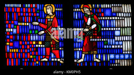 Stained Glass in Wormser Dom in Worms, Germany, depicting Two Catholic Saints - Stock Photo