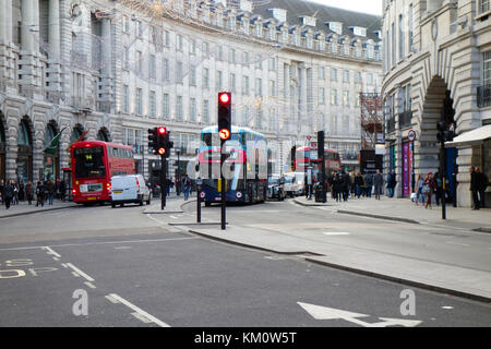 London buses at the entrance to Regent Street, London, England, UK - Stock Photo