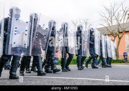 16th February 2013, Belfast, Northern Ireland, UK. PSNI officers in riot gear with Armadillo crowd control shields - Stock Photo