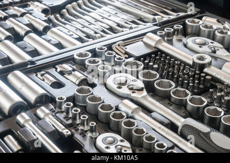 Sockets, tools, wrenches, spanners and bits in a chrome vanadium socket set. - Stock Photo