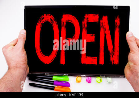 Open text written on tablet, computer in the office with marker, pen, stationery. Business concept for shop Opening - Stock Photo