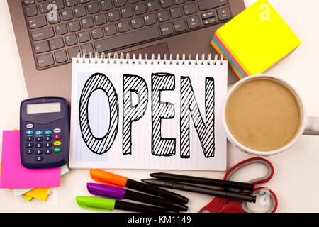 Word writing Open in the office with laptop, marker, pen, stationery, coffee. Business concept for shop Opening - Stock Photo