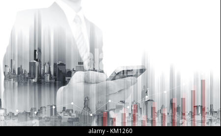 Double exposure Businessman using mobile smart phone with modern buildings. Business growth and investment - Stock Photo