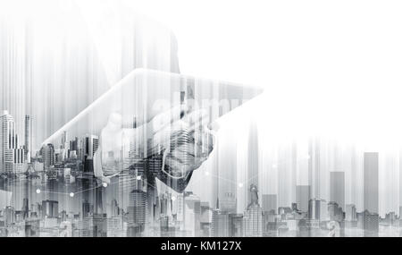 Double exposure Businessman working on digital tablet with modern buildings. Business growth and investment - Stock Photo