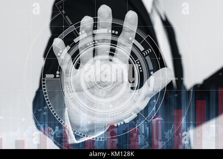 Businessman working on digital virtual interactive screen, with raising graph - Stock Photo