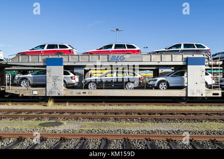autorack with new Skoda cars for export to Scandinavia at BLG Logistics seaport terminal in Cuxhaven, Germany - Stock Photo