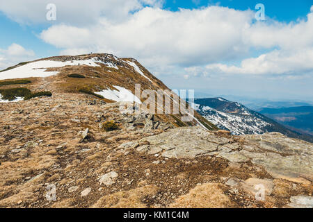unidentified hikers travel in the Babia Gora Mountain with a backpackes - Stock Photo