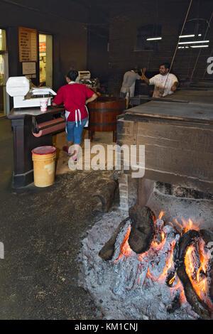 Texas, Caldwell County, Lockhart, Smitty's Market, barbecue restaurant, smoker, wood fire - Stock Photo