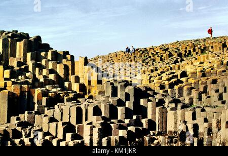 The Giants Causeway near Bushmills, Ireland. Volcanic basalt rock hexagonal columns of the Honeycomb and the Grand - Stock Photo