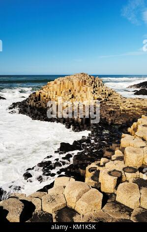 The Giants Causeway near Bushmills, Northern Ireland. Volcanic basalt rock hexagonal columns of the Honeycomb formation. - Stock Photo