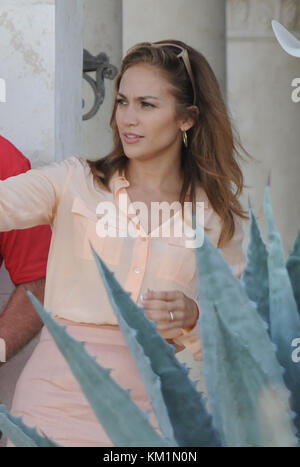 PALM BEACH, FL - SEPTEMBER 23: Actress/Singer Jennifer Lopez, and English actor Jason Statham on set filming their - Stock Photo