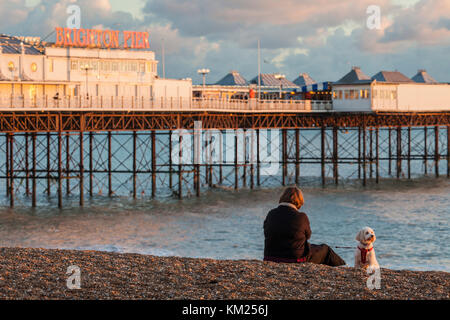 Autumn sunset on Brighton beach, East Sussex, England. - Stock Photo