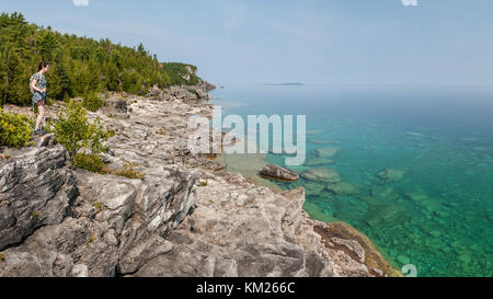 Woman hiking in the Bruce Peninsula, Ontario, Canada - Stock Photo