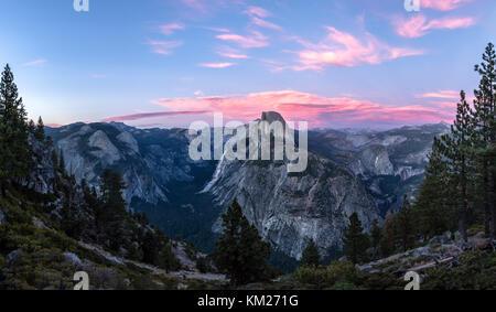 Dramatic sky over Half Dome in Yosemite National Park, California, USA - Stock Photo