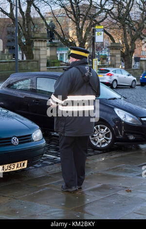 Traffic warden or civil enforcement officer issuing parking tickets in Liverpool city centre, merseyside, UK. - Stock Photo