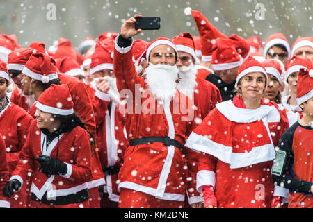 London, UK. 3rd Dec, 2017. Thousands join the annual Santa Run for charitable causes in Victoria Park. Credit: Guy - Stock Photo