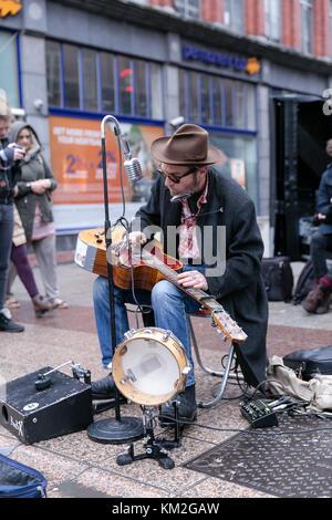 Dublin, Ireland. 3rd Dec, 2017. One Man Band or Orchestra Man busking on Grafton Street in Dublin bringing Christmas - Stock Photo