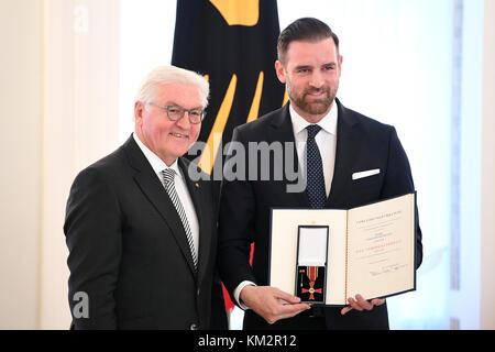German President Frank-Walter Steinmeierawards former soccer player Christoph Metzelder the Order of Merit on the - Stock Photo