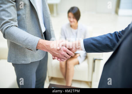 Business People Shaking Hands Close Up - Stock Photo