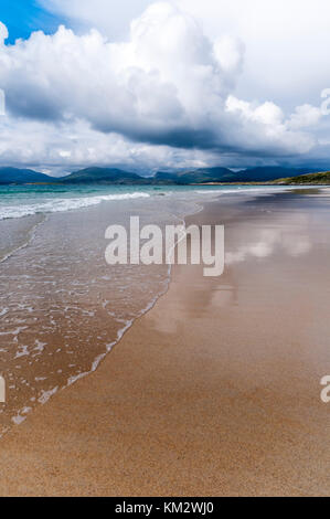 Clouds reflected on the wet sand of Luskentyre beach and the Sound of Taransay on South Harris in the Outer Hebrides.
