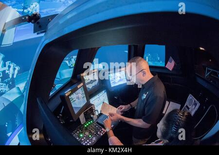 Expedition 53 American astronaut Randy Bresnik during simulation training in the Cupola robotics class in Alpha - Stock Photo