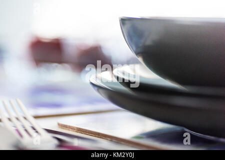 Table setting - cutlery, napkins and soft bokeh background - Stock Photo