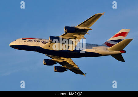 Airbus A380, British Airways, Heathrow Airport, UK. Airbus A380-841 G-XLEG is seen flying away after take-off at - Stock Photo