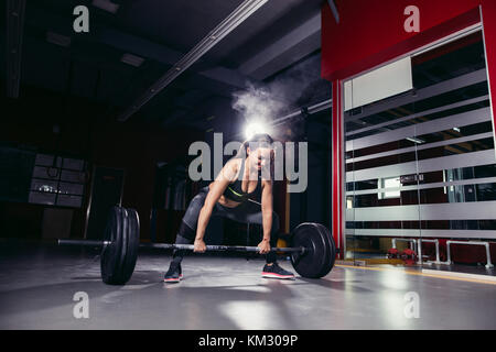 Cross fit woman in the gym - Stock Photo