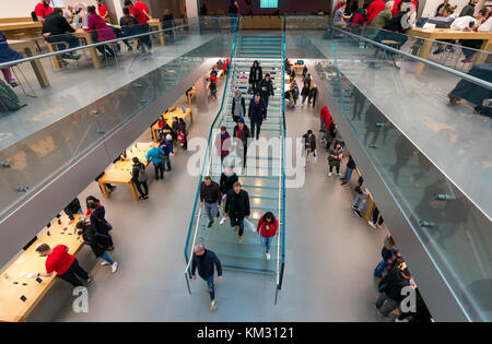 Overhead view inside the SoHo Apple Store in New York City - Stock Photo